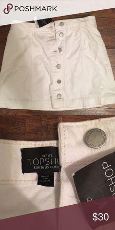 White Denim Skirt Topshop Petite, white denim skirt  Size 4, never worn Topshop PETITE Skirts Mini