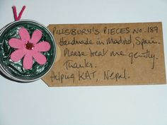 Pillsbury's Pieces No, 187. Pin with metallic teal capsule with pink flower. In exchange for a donation to KATHMANDU ANIMAL TREATMENT CENTRE, Nepal. SOLD at St. George's Church, Madrid on Saturday 13 June.