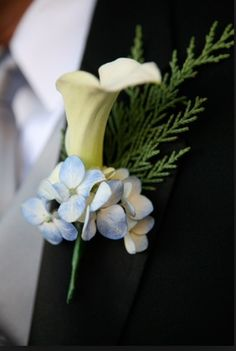 Blue hydrangea with white calla lily boutonnière for groom