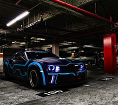 Camaro... Notice the blue stripes.  IDEA:  Use light strips to simulate TRON style vehicle at night.
