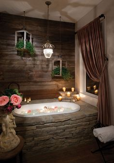 Dormer had a stone mason create a stone surround for the bathtub after seeing the same in a photo many years before. The result: a romantic oasis.