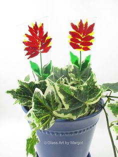 A fused glass flower poke makes a great addition to a house plant or flower pot. The orange red Indian paint brush flower in this plant stake will add color even when flowers arent in bloom. Use it in the garden or in a flower pot. Each one is a unique one of a kind piece. Makes a great gift for Mothers Day, Teacher Appreciation, Get Well, Housewarming.  This listing is for one plant stake.  Size is approximately 9.25 x 2.5