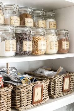 Pantry Cabinet Organization and Free Printable Label Set | blesserhouse.com - A cabinet gets a drastic organization makeover using inexpensive IKEA jars / baskets, hanging storage, and a free pantry label printable set. #organization #freeprintables