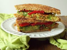 Vegan Avocado Melt with Coconut Bacon - avocado, lime, salt, pepper, sandwich bread, coconut bacon (liquid smoke, olive oil, soy sauce, maple syrup [would omit or sub sugar-free], apple cider vinegar, smoked paprika, unsweetened coconut flakes), jarred roasted red pepper slices, fresh cilantro, olive oil (would omit and cook in panini maker)