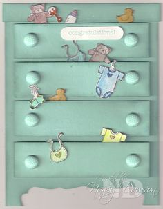 Chest of drawers with scattered baby clothes and toys makes a great handmade baby card.  Shade the edges of each drawer and add brads for drawer pulls.