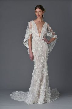 Marchesa Spring 2017 sheath wedding dress with plunging neckline and floral and lace embroidered cape