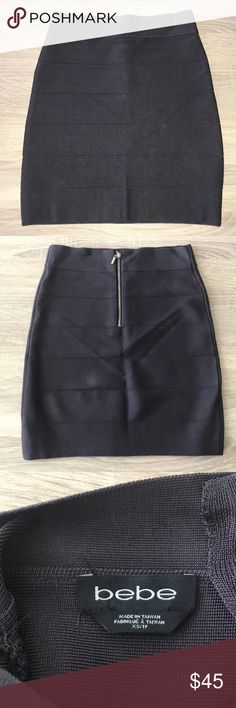 BEBE bandage skirt This beautiful dark gray/purple bandage skirt is in great condition worn only a few times! Size XS with zipper in the back. No trades, open to offers (: bebe Skirts Mini