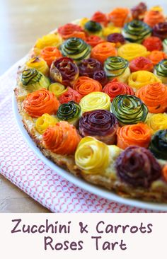 zucchini carrots roses tart recipe A stunning savory tart that will surprise your family: zucchini and carrots roses on a bed of ricotta, parmesan and mozzarella cheese.zucchini carrots roses tart recipe, this is too cute to leave off of the to do li Tart Recipes, Veggie Recipes, Vegetarian Recipes, Cooking Recipes, Pastry Recipes, Vegetarian Tart, Cooking Tips, Vegetarian Options, Veggie Food