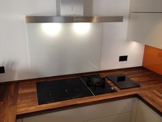 Glass splashback on ALNO kitchen with Spekva walnut worktops. By Phil Harflett Walnut Worktops, Alno Kitchen, Kitchen Showroom, Stylish Kitchen, Splashback, Bristol, Kitchens, Glass, House