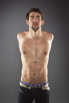 Swimmer Michael Phelps stretches while posing for a portrait during the 2012 U.S. Olympic Team Media Summit in Dallas May 13, 2012. www.london2012.com #Sport #Olympics #Photography #London2012 #Portrait #Photography #Swimming