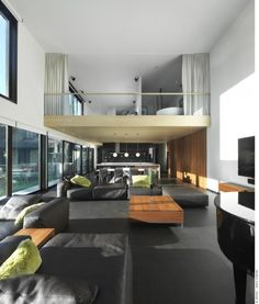 Affordable Living Room Furniture: Attractive Black Living Room Furniture And Wooden Table For Contemporary Interior Design In Minimalist Style With Double Height Ceiling ~ fsupgm.com Living Room Inspiration