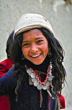girl carrying sister - in 1981, in the remote mountain kingdom of Zangla ( Zanskar) in the High Himalayas - Ashok Nath