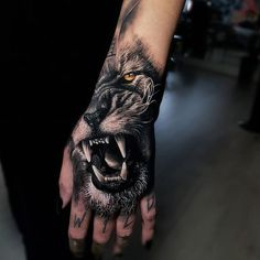 Realistic Tattoos with Morphing Effects by Benji Roketlauncha - awesome lion ta., Realistic Tattoos with Morphing Effects by Benji Roketlauncha - awesome lion tattoo © tattoo artist Benji_Roketlauncha Tiger Hand Tattoo, Lion Hand Tattoo Men, Hand Tats, Hand Tattoos For Guys, Lion Tattoo, Baby Name Tattoos, Leg Tattoos, Arm Tattoo, Body Art Tattoos