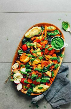 30-minute, colorful roasted vegetable salad over greens with macadamia nut cheese and chimichurri dressing! A satisfying plant-based meal or side!