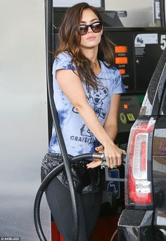 Rock chick: Megan Fox was seen pumping gas in Beverly Hills on Saturday wearing a Grateful...