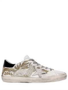 GOLDEN GOOSE DELUXE BRAND, 20mm super star embellished sneakers, White/black, Luisaviaroma - 20mm Rubber sole. Leather upper. Embellished with beads and embroidery . Contrasting color heel detail. Vintage effect may vary. Terrycloth lining. Any variation in color or detailing is a result of the handcrafted nature of this item. Slight imperfections are not to be considered defects, but add to its value and unique character.