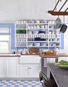 Blue and white kitchen with open shelves. I'm thinking one of these would be a nice focal point in a kitchen. I could see my pretty dishes, and I'd be forced to keep my cupboards tidy!
