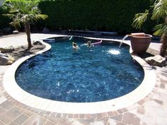 Spa Waterfall With Smaller Rock Water Feature Along Back Textured Deck Diamond Brite Cobalt