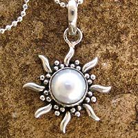 "$49.99 Pearl pendant necklace, 'Quiet Sun'    Measurements:  Chain: 15.75"" L  Pendant: 1.4"" L x 0.8"" W x 0.3"" D  Features:      Sterling silver and cultured pearl     Spring ring clasp  Made in  India"