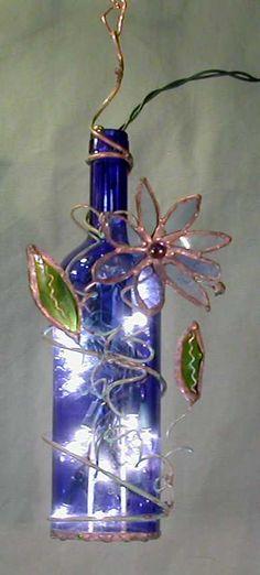 bottle light - blue.  con botellas rotas