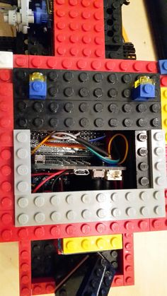 Micro Bit controller with breakout board to wire servos and LED frontlight. The shocksensor is used to switch everything of in case of a crash.