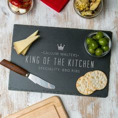 A slate or wooden serving board engraved with your details of choice, perfect for your King Of The Kitchen!