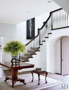 Feng shui-wise, a staircase can create a challenging energy that can be unsettling. Use these feng shui tips to improve the energy of your staircase. Feng Shui, Entry Stairs, Entry Hallway, Hallway Ideas, Hotel Hallway, Grey Hallway, Hallway Mirror, South Shore Decorating, Foyer Decorating
