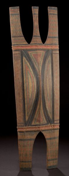 A FILIPINO PAINTED WOOD SHIELD  Kalinga, early 20th century