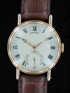 Breguet - Manual Wrist Watch. 18 Karat Yellow Gold, with Leather Strap. Paris, France.