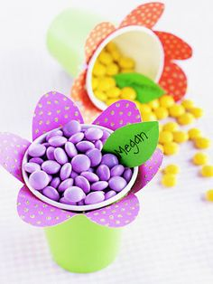 Easter place cards for the kids table  M&M's in different colors.  would use smaller nut cups.