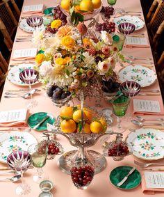 Oranges, family China, malachite, eggplant champagne coupes, and mismatched flatware.