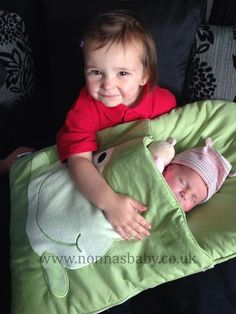 """What a gorgeous photo of little baby Ellie in her nap mat being held by her cousin Roxanne! Mum Cody told us """"This nap mat was a god send when baby Ellie was born, I had a c section & using this made it so much easier for me to safely pass my baby around to friends/family & made me feel extra secure while she was being held by my nieces & nephews.""""  Nonna is delighted! :-)"""