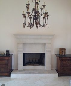 CAST STONE FIREPLACE MANTELS Cast stone fireplace surround in Baton Rouge, LA. This cast stone mantel is custom made.  It is 76'' wide and 79'' tall.  http://www.southernstonecrafters.com