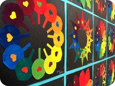 color wheels by jodie hurt, via Flickr-students paint out squares of all the color wheel colors using only the primaries and then create cut out color wheels-great for MS