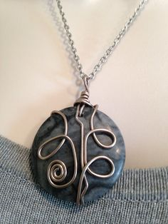 A personal favorite from my Etsy shop https://www.etsy.com/listing/242668815/wire-wrap-pendant-necklace-grey-black