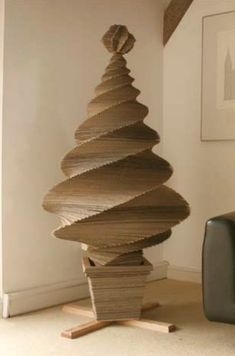 cardboard Christmas tree... provides an inkling of what else could be made out of corrugated cardboard!