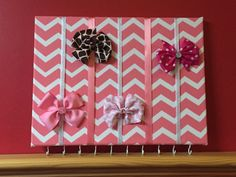 Pink / Coral Chevron Hair Bow Holder Hair Bow Organizer by RaftsCrafts on Etsy https://www.etsy.com/listing/188974301/pink-coral-chevron-hair-bow-holder-hair