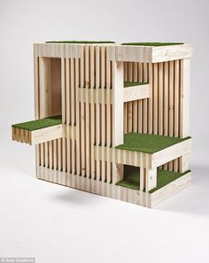 Slats: According to RNL, 'Our Kitty Condo allows cats to survey the world from multiple turf-lined vantage points while comfortably hiding behind 23 layers of wood slats, which protect them from harm'
