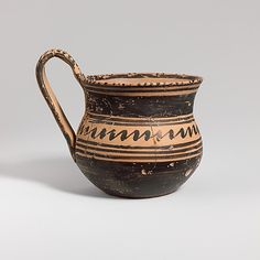 Terracotta tankard    Period:      Geometric  Date:      late 8th century B.C.  Culture:      Greek, Attic  Medium:      Terracotta  Dimensions:      H. with handle 4 in. (10.1 cm)  Classification:      Vases