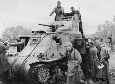 Africa Corps Wehrmacht servicemen inspect captured tank M3 1st U.S. Armored Division in Tunisia in the garden.