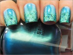 """""""I started with Sally Hansen Lagoon, a blue/green duochrome. Love the color but the brushstrokes were a bit too noticeable for me. Then I dabbed Mermaid Tale on the tips until I got enough glitter coverage."""" --Want to do this when my nails get a little longer"""
