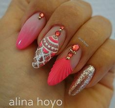 Nude and coral almond shape nails with nail art design