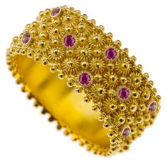 Filigiree jewellery. 18k Gold with rubies, Fedele wedding band- The ring represents fidelity and long lasting love and loyalty. The design is inspired by the ears of corn which are originally linked to the wish of wealth and prosperity according to Sardinian tradition.   Visit www.kokku.co.uk
