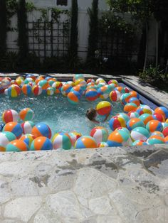 Idea for game: scatter beach balls in pool. Time how long it takes each team to move them to one side of the pool