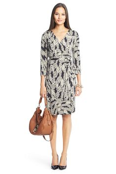 Effortlessly chic every time, the New Julian Two wrap dress is a modern take on a DVF classic. Cross over wrap with a self-tie belt. 3/4 sleeves. Unlined. In our seasonless silk jersey. Falls to above knee. Fit runs small.