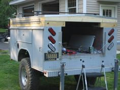 Utility bed trailer with platform for regular tent on top.