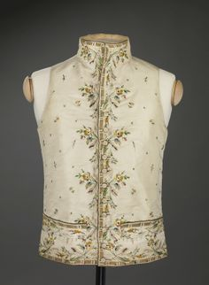 Vest, c. 1800. Cream silk taffeta embroidered with flower sprays and floral motifs.