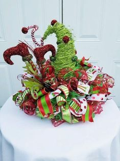If you haven't yet thrown your own Ugly Christmas Sweater Party, now is the time and here are some great resources to pull it off. Cool Christmas Trees, Christmas Lanterns, Christmas Ribbon, Christmas Store, Christmas Christmas, Christmas Table Centerpieces, Christmas Arrangements, Christmas Party Decorations, Holiday Decor