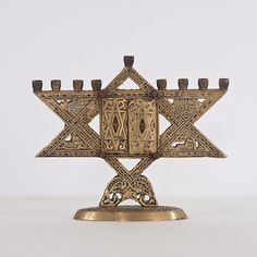 Vintage Hanukkah Menorah, Brass Menorah Judaica, Israeli Menorah, Magen David Condition: Some parts are oxidized due its age, as seen in the images. Diy Hanukkah, Hanukkah Decorations, Hanukkah Menorah, Hannukah, Baseball Birthday, Baseball Party, Jewish Art, Candle Stand, Festival Lights