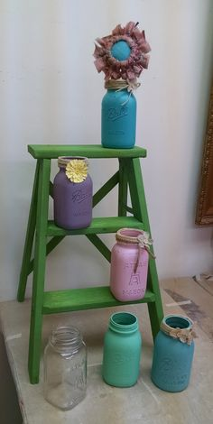 Painted Mason Jars & Fabric Flowers. Tattered & Worn has a workshop for the do-it-yourselfers!